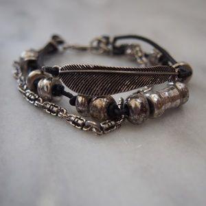 Three strand silver feather bracelet